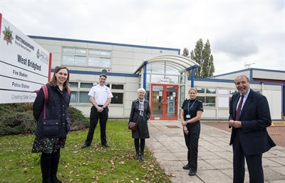 5 people standing in front of the police and fire station West Bridgford
